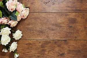 white and pink roses on rustic wood background stock photo