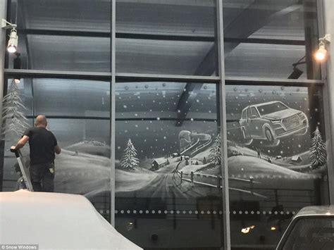 artist tom baker uses snow spray to create winter