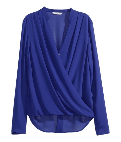 h m draped top lyst h m draped wraparound blouse in blue