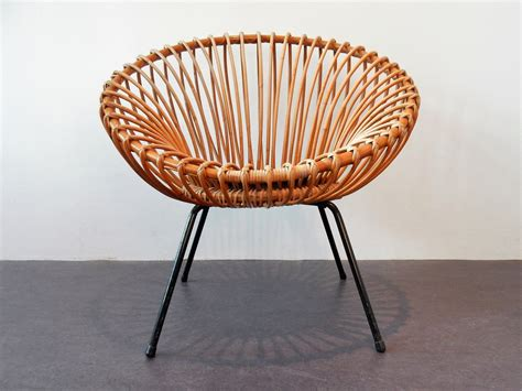 Rattan is the perfect material for outdoor furniture , since it's amazingly durable through extreme conditions of humidity and temperature, while still remaining lightweight and easy to handle. Mid-Century Rattan Scoop Chair for sale at Pamono