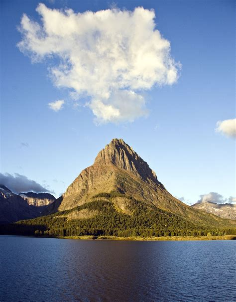 From middle english mount, munt, from old english munt, from latin mons (a hill, mountain), from a root seen also in ēmineō (i project, i protrude) (english eminent). Mount Grinnell - Wikipedia