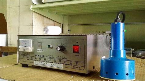 manual induction aluminum foil sealing machine video  square bottles desktop bottle sealer