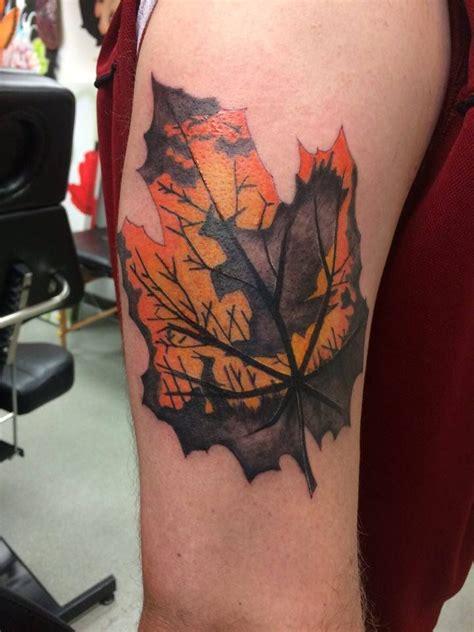 silhouette maple leaf tattoo sleeve work colourful