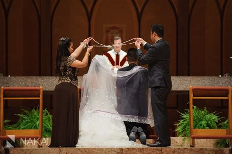 Filipino Wedding Tradition, The Cord Over Bride And Groom. Picture At Chicago Holy Name Bridal Jewelry And Accessories Wedding For Mother Of The Groom Set Bride Charming Charlie Photos Anniversary Giveaways Philippines Metals Dance Floor