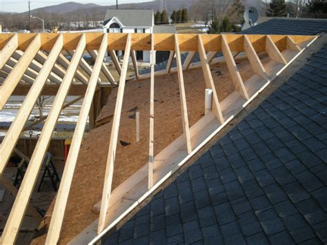 Framing A Hip Roof Addition by Tying Addition Roof To Existing Roof Ventilation