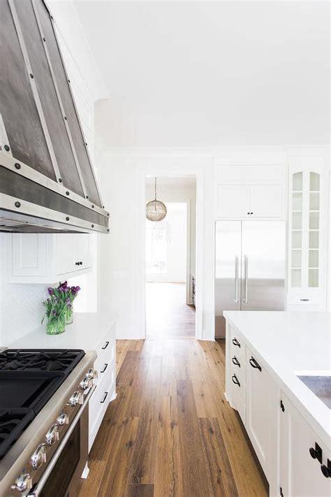 white shaker kitchen cabinets  bronze knobs  pulls transitional kitchen