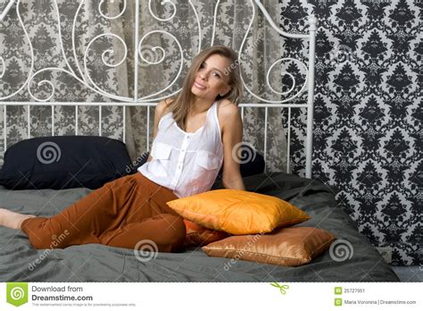 Pretty Girl Sitting On Bed Stock Image  Image 25727951