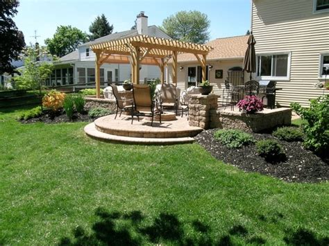 patio pergola fire pit sitting walls patio landscaping outdoor lighting traditional