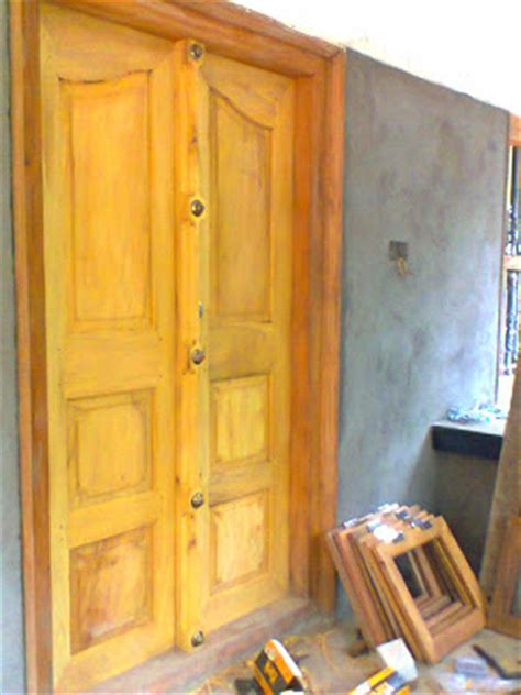 kerala style carpenter works  designs main entrance wooden double door collections