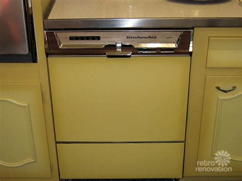Never used! A 1960s harvest gold kitchen for sale in
