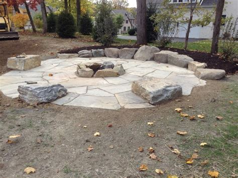Paver Patio Ideas With Fire Pit by Large Fire Pit Area With Boulder Tables And Rock Wall