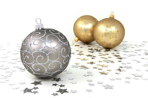 and gold ornaments ornaments free stock photo silver and gold christmas ornaments with silver stars on a white