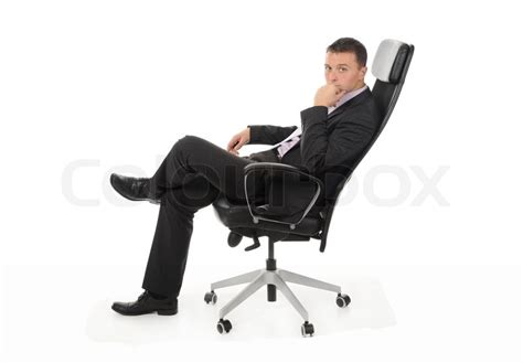 businessman sitting in a chair in a bright office isolated