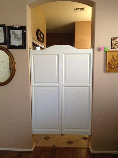 painted white swinging cafe doors  kitchen entry