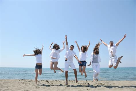 happy people group have fun and running on beach - Hot ...