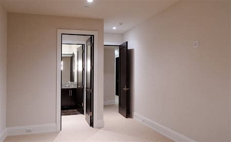 Interior design with black doors and white walls and white