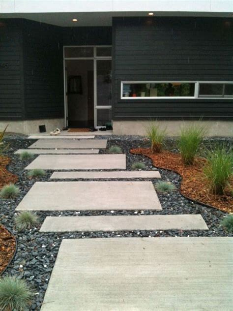 modern concrete pavers walkways enhance home s curb appeal www ajc com george vail designed the staggered front