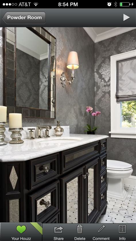 Powder room wallpaper; shiny silver, gray, black. white