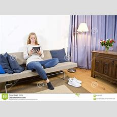 Woman Surfing On A Tablet In A Living Room Stock Image
