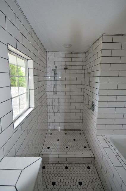 large walk  doorless shower  white subway tile