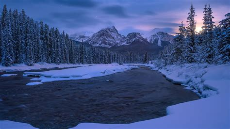 Alberta Canadian Rockies Mountain River Covered With Snow