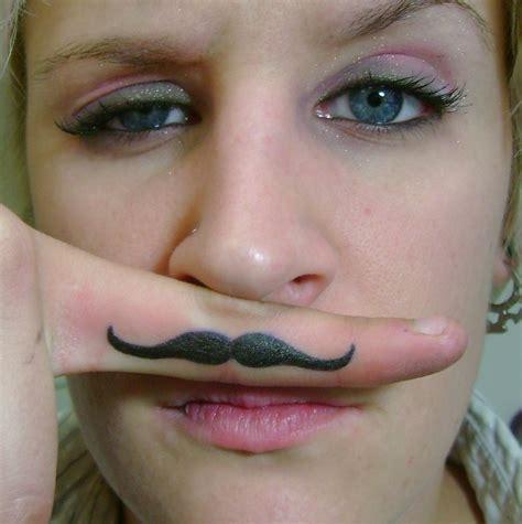 girl  black mustache finger tattoo