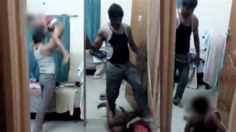 father brutally beats son arrested  video  viral