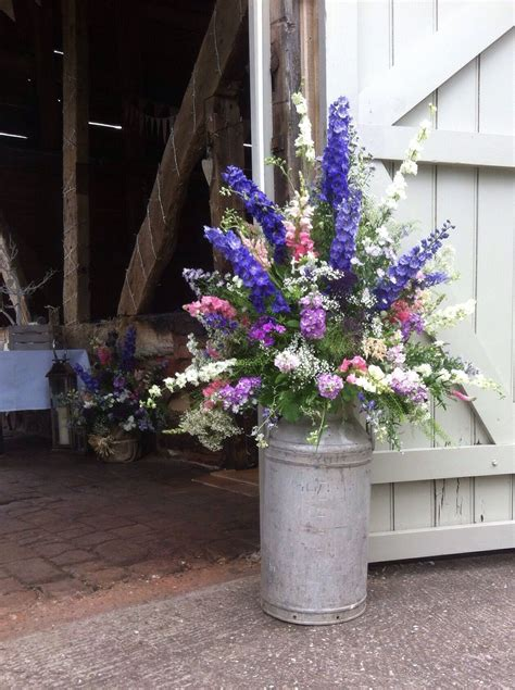 country garden flowers arranged  milk churn  www