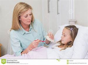 Mother Giving Her Daughter Cough Medicine Stock Photo ...