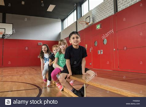 bench childrens clothing children resting on bench before exercises in large of