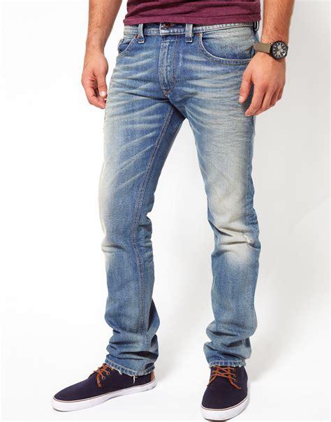light blue jeans mens slim fit diesel jeans thavar slim fit light wash in blue for men lyst