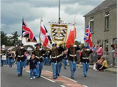 FileRed Hand Defenders flute band parade in