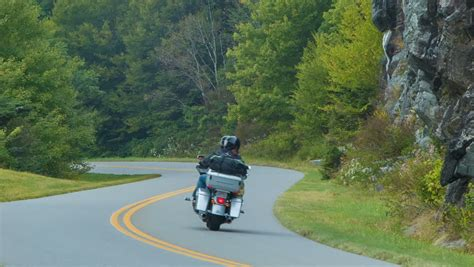 tourists on a motorcycle the blue ridge parkway in