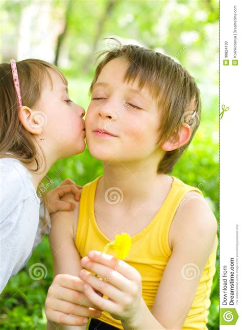 young girl   brother  kiss   cheek stock