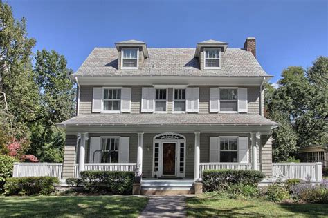 grey house white shutters traditional exterior also blue siding board and batten brick brick