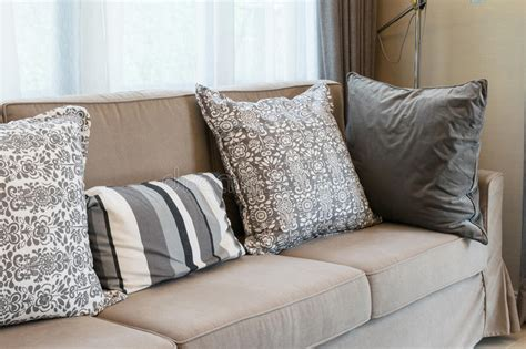 Brown Tweed Sofa With Grey Pillows Stock Photo