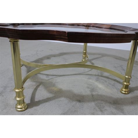 A glass top coffee table is an easy way to create a trendy look. Quality Brass Base Scalloped Wood and Glass Tray Top Coffee Table   Chairish