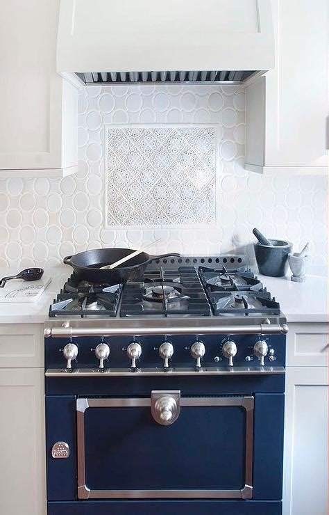 Blue French Stove with Oval Backsplash Tiles