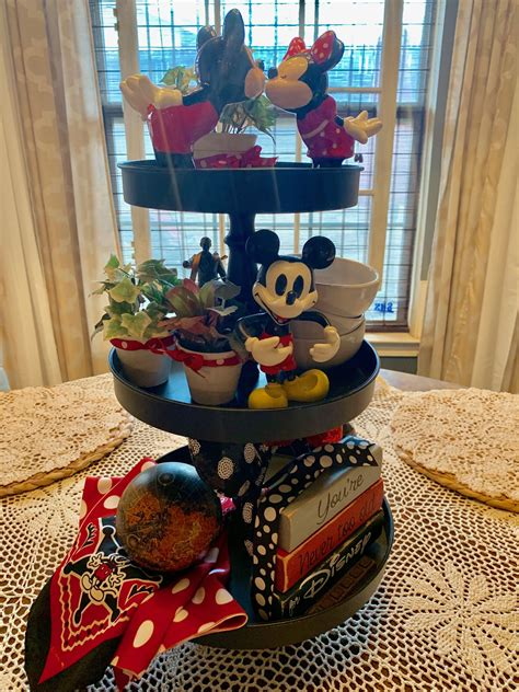 Display books, decor, and artwork on this spacious, open studio home bookcase by hammary. Mickey tiered tray. Disney Home. | Tiered tray decor, Disney home decor