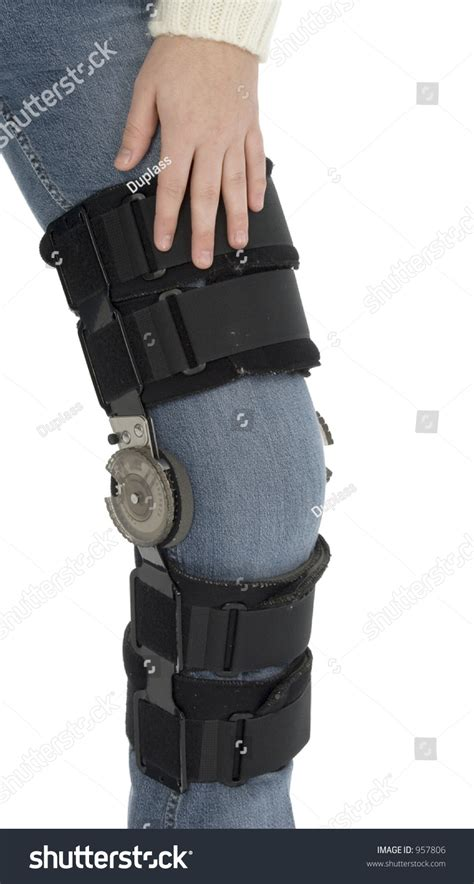womans leg wearing knee brace  jeans shot  studio