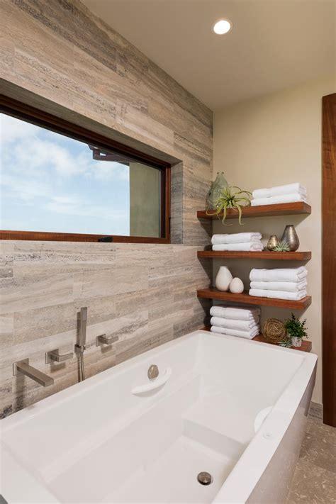 modern floating shelves  white bathtub  neutral