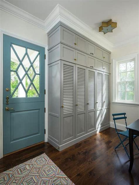 turquoise blue door opens   mudroom features built