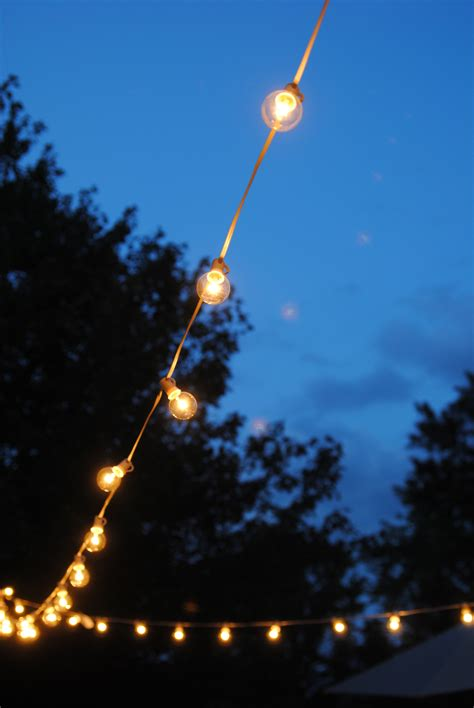 how to string lights outside how to hang outdoor string lights the deck diaries part