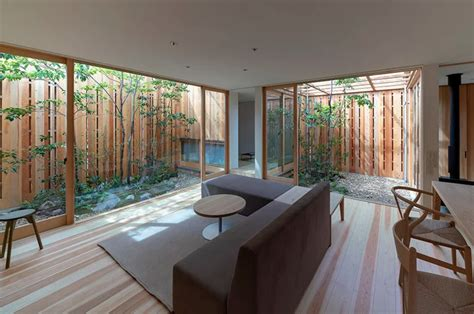 modern japanese house tucks courtyards curbed