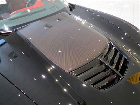 black    exposed carbon fiber hood beautiful