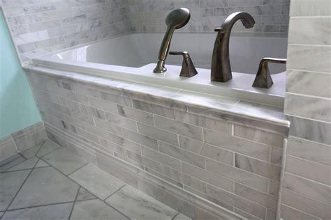 white carrara marble tub surround  brushed nickel