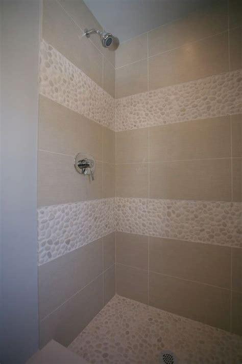 white pebble tile tile shower pan shape  stones