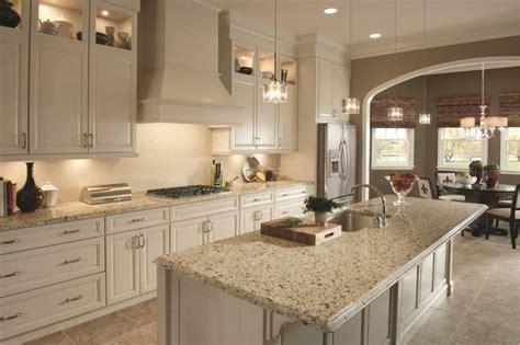 crema caramel granite countertops with backsplash