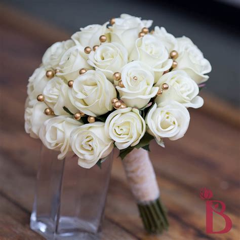 ivory  gold wedding flowers