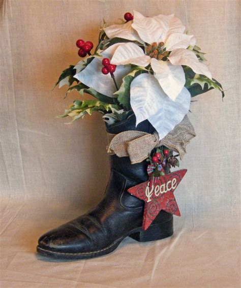 cowboy boot christmas decoration floral arrangement with star ornament on etsy 25 00